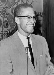 A smiling Malcolm X.