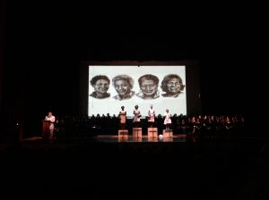 Actresses playing the role of the four little girls who have been killed. The image behind them represents how they might have looked 50 years later.
