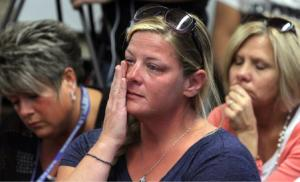 """In this Friday, Oct. 3, 2014 photograph, audience members react as members of the Sayreville Board of Education hold a press conference at the Selover School in South Amboy, N.J., to address a hazing incident that """"went too far"""" and is at the center of the investigation into the Sayreville War Memorial High School football team. On Monday, Oct. 6, 2014 school superintendent Richard Labbe said the Sayreville War Memorial High School football season has been canceled amid allegations of harassment, intimidation and bullying among players. (APPhoto/ Home News Tribune, Mark R. Sullivan) On Friday October 3,,2014 Photo: Mark R. Sullivan/Home News Tribune/AP"""