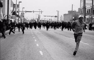 Baltimore protester on the run, 2015. Photo by: Devin Allen