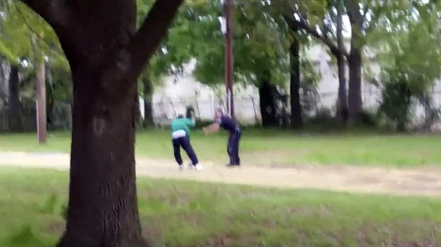 FILE-In this April 4, 2015 file image from video, Walter Scott struggles with police officer Michael Thomas Slager in Charleston, S.C. South Carolina legislator, Rep. Justin Bamberg, wants to bar law enforcement agencies from setting traffic ticket quotas or evaluating officers by the number of citations they write, saying that forces officers to pull people over for minor violations. Bamberg, an attorney for the family of Walter Scott, points to ex-officer Michael Slager's own defense attorney saying his client wouldn't have stopped Scott in the first place _ for a broken third brake light _ if not for quotas. (Feidin Santana via AP Images, File)